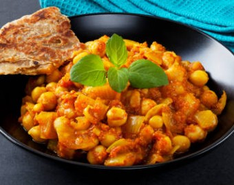 A bowl of hot and sour chickpeas, chana masala, with mint and paratha. For MANY MANY MORE curries please click [url=http://www.istockphoto.com/file_search.php?action=file&lightboxID=3096983]here[/url].