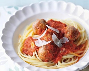 Red pepper and tomato sauce over fish balls